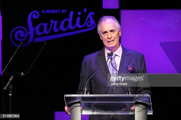 Honoree Keith Carradine speaks onstage during the 24th and final A Night at Sardi's to benefit the Alzheimer's Association at The Beverly Hilton...