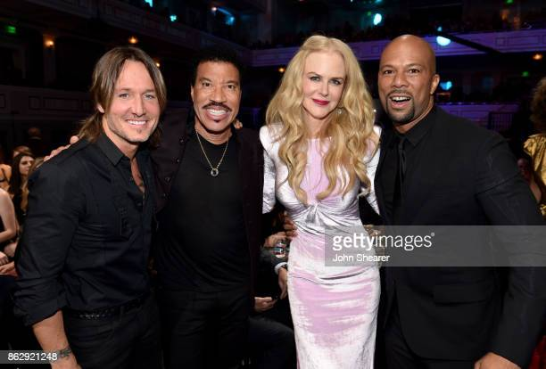Honoree Keith Urban singersongwriter Lionel Richie actress Nicole Kidman and singersongwriter Common take photos at the 2017 CMT Artists Of The Year...