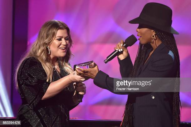 Honoree Kelly Clarkson accepts the Powerhouse Award from Kelly Rowland onstage during Billboard Women In Music 2017 at The Ray Dolby Ballroom at...