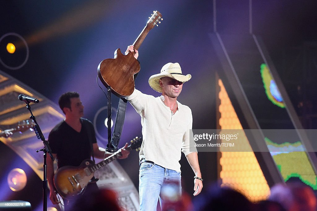 Honoree Kenny Chesney performs onstage during the 2014 American Country Countdown Awards at Music City Center on December 15, 2014 in Nashville, Tennessee.