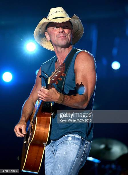 Honoree Kenny Chesney performs onstage during the 50th Academy of Country Music Awards at ATT Stadium on April 19 2015 in Arlington Texas