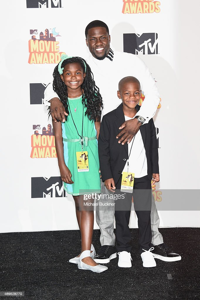 Honoree Kevin Hart (C), recipient of the Comedic Genius Award, poses with Heaven Hart (L) and Hendrix Hart (R) in the press room during The 2015 MTV Movie Awards at Nokia Theatre L.A. Live on April 12, 2015 in Los Angeles, California.