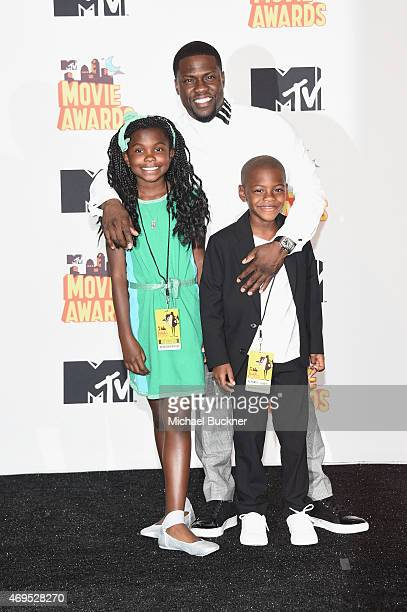 Honoree Kevin Hart recipient of the Comedic Genius Award poses with Heaven Hart and Hendrix Hart in the press room during The 2015 MTV Movie Awards...