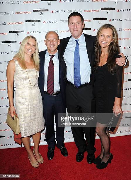 Honoree Kevin Mayer from the Walt Disney Company and cofounder of CoachArt Zander Lurie and their wives attend the CoachArt Gala Of Champions at The...