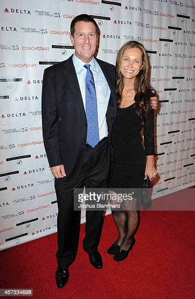 Honoree Kevin Mayer from the Walt Disney Company and Lisa Mayer arrive at the CoachArt Gala Of Champions at The Beverly Hilton Hotel on October 16...