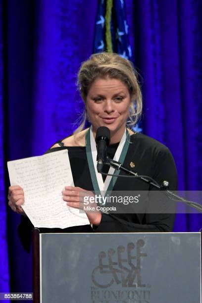 Honoree Kim Clijsters speaks onstage at the 32nd Annual Great Sports Legends Dinner To Benefit The Miami Project/Buoniconti Fund To Cure Paralysis at...