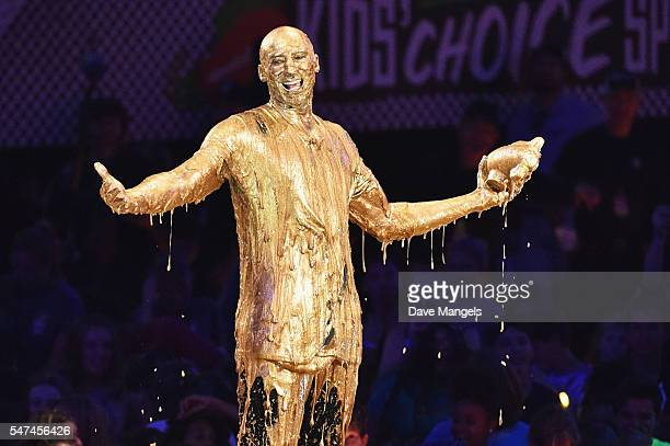 Honoree Kobe Bryant accepts the Legend Award and gets slimed onstage during the Nickelodeon Kids' Choice Sports Awards 2016 at UCLA's Pauley Pavilion...