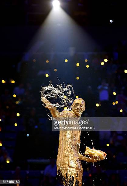 Honoree Kobe Bryant reacts after being slimed while accepting the Legend award onstage during the Nickelodeon Kids' Choice Sports Awards 2016 at...