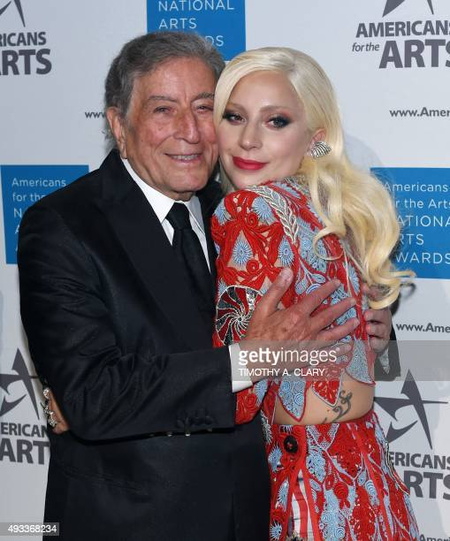 Honoree Lady Gaga poses with Tony Bennett as they arrive for the Americans for the Arts annual gala the National Arts Awards October 19 2015 at...