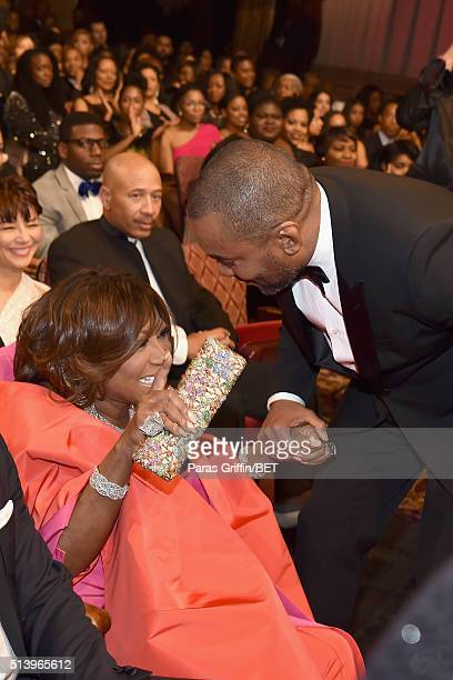 Honoree Lee Daniles greets honoree Patti LeBelle at the BET Honors 2016 Show at Warner Theatre on March 5 2016 in Washington DC