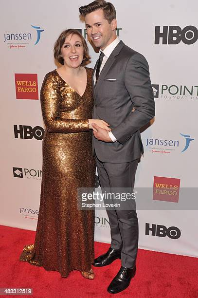 Honoree Lena Dunham and Andrew Rannells attend the Point Honors New York gala at New York Public Library on April 7 2014 in New York City