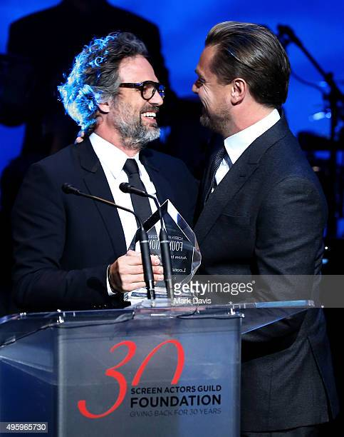 Honoree Leonardo DiCaprio accepts the Patron of the Artists Award onstage from actor Mark Ruffalo during the Screen Actors Guild Foundation 30th...