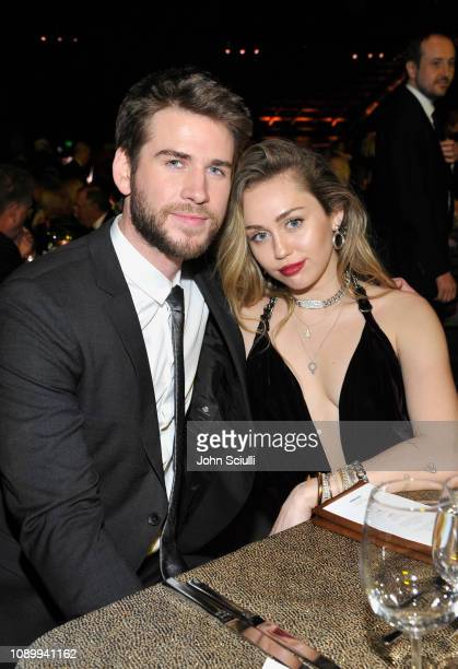 Honoree Liam Hemsworth and Miley Cyrus attend the 2019 G'Day USA Gala at 3LABS on January 26 2019 in Culver City California
