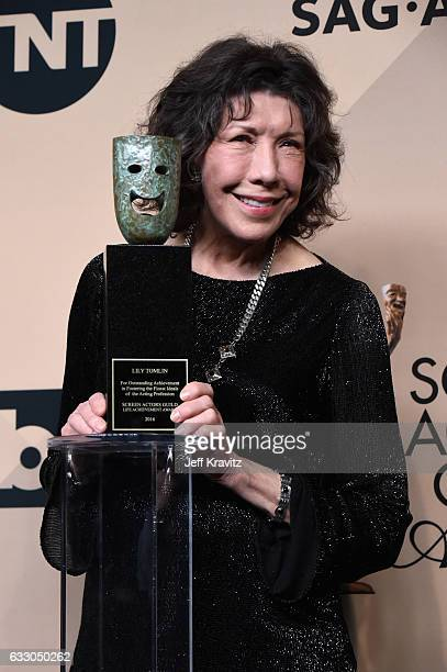 Honoree Lily Tomlin, recipient of the SAG Life Achievement Award, poses in the press room during the 23rd Annual Screen Actors Guild Awards at The...