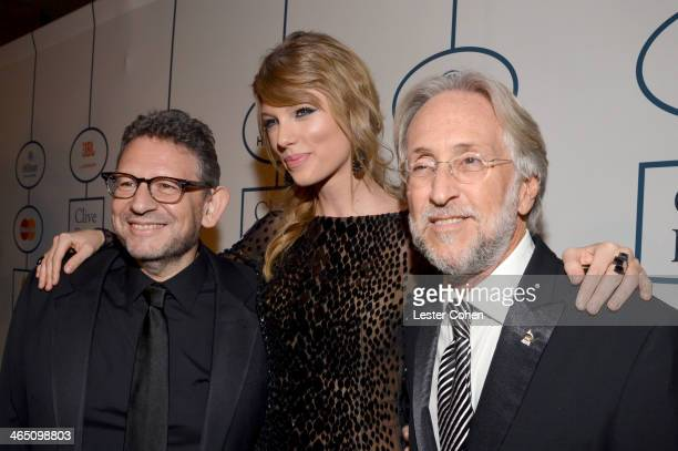 Honoree Lucian Grainge singer Taylor Swift and Recording Academy President/CEO Neil Portnow attend the 56th annual GRAMMY Awards PreGRAMMY Gala and...