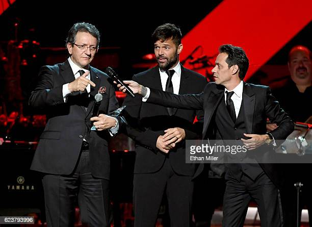 Honoree Marc Anthony accepts the Person of the Year award from Latin Academy of Recording Arts Science President/CEO Gabriel Abaroa and singer Ricky...