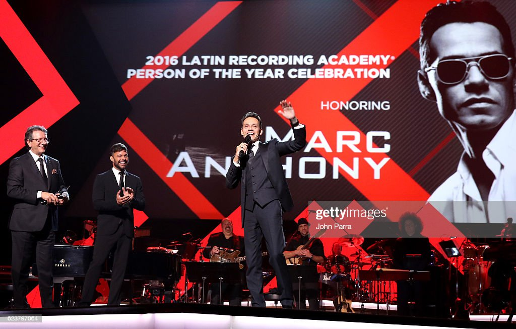 Honoree Marc Anthony (R) accepts the Person of the Year award from Latin Academy of Recording Arts & Science President/CEO Gabriel Abaroa and singer Ricky Martin onstage during the 2016 Person of the Year honoring Marc Anthony at MGM Grand Garden Arena on November 16, 2016 in Las Vegas, Nevada.