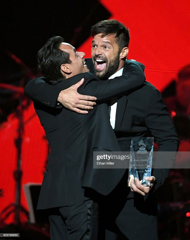 Honoree Marc Anthony (L) accepts the Person of the Year award from singer Ricky Martin onstage during the 2016 Person of the Year honoring Marc Anthony at MGM Grand Garden Arena on November 16, 2016 in Las Vegas, Nevada.
