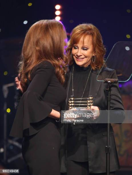 Honoree Maria Shriver and Reba McEntire onstage at Celebrity Fight Night XXIV on March 10 2018 in Phoenix Arizona
