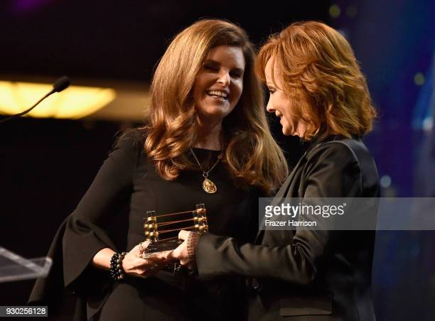 Honoree Maria Shriver and Reba McEntire speak onstage at Celebrity Fight Night XXIV on March 10 2018 in Phoenix Arizona