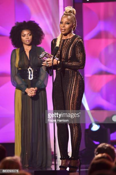 Honoree Mary J Blige accepts the Icon Award from Taraji P Henson onstage at Billboard Women In Music 2017 at The Ray Dolby Ballroom at Hollywood...
