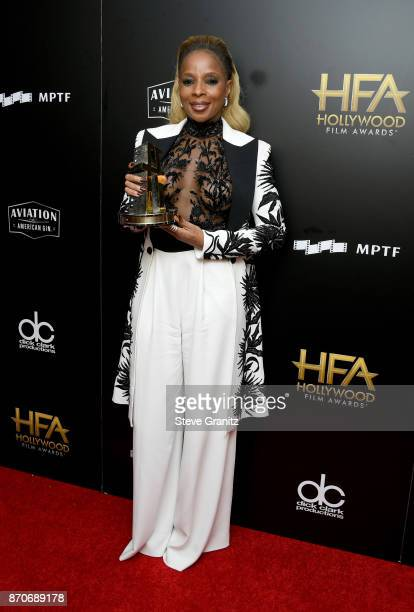 Honoree Mary J Blige recipient of the Hollywood Breakout Performance Actress Award for 'Mudbound' poses in the press room during the 21st Annual...