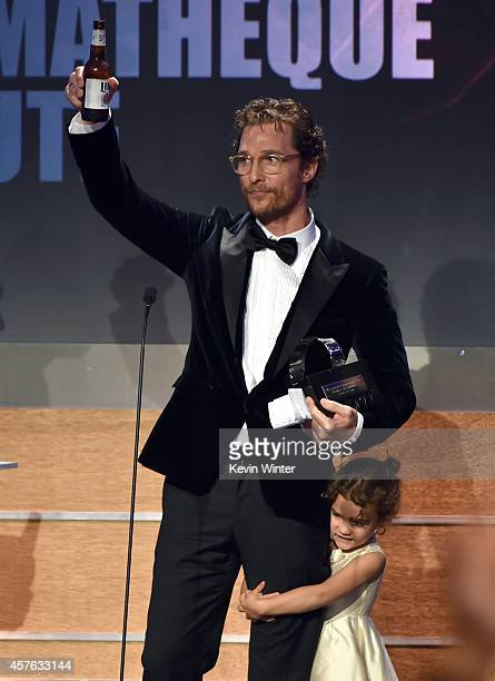 Honoree Matthew McConaughey accepts the American Cinematheque Award with Vida Alves McConaughey onstage at the 28th American Cinematheque Award...