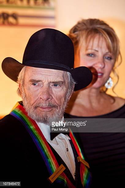 Honoree Merle Haggard and Theresa Ann Lane arrive at the 33rd Annual Kennedy Center Honors at the Kennedy Center Hall of States on December 5 2010 in...