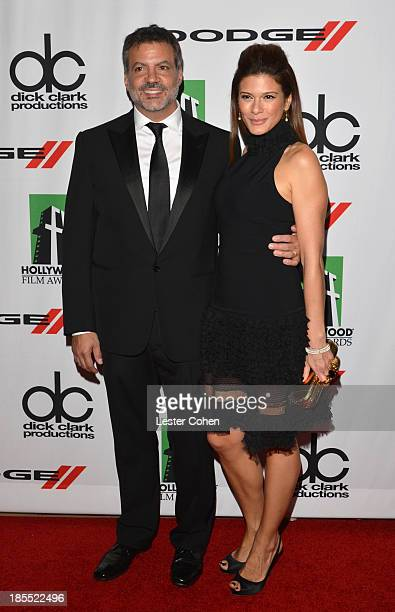 Honoree Michael DeLuca and wife Angelique Madrid arrive at the 17th Annual Hollywood Film Awards at The Beverly Hilton Hotel on October 21 2013 in...