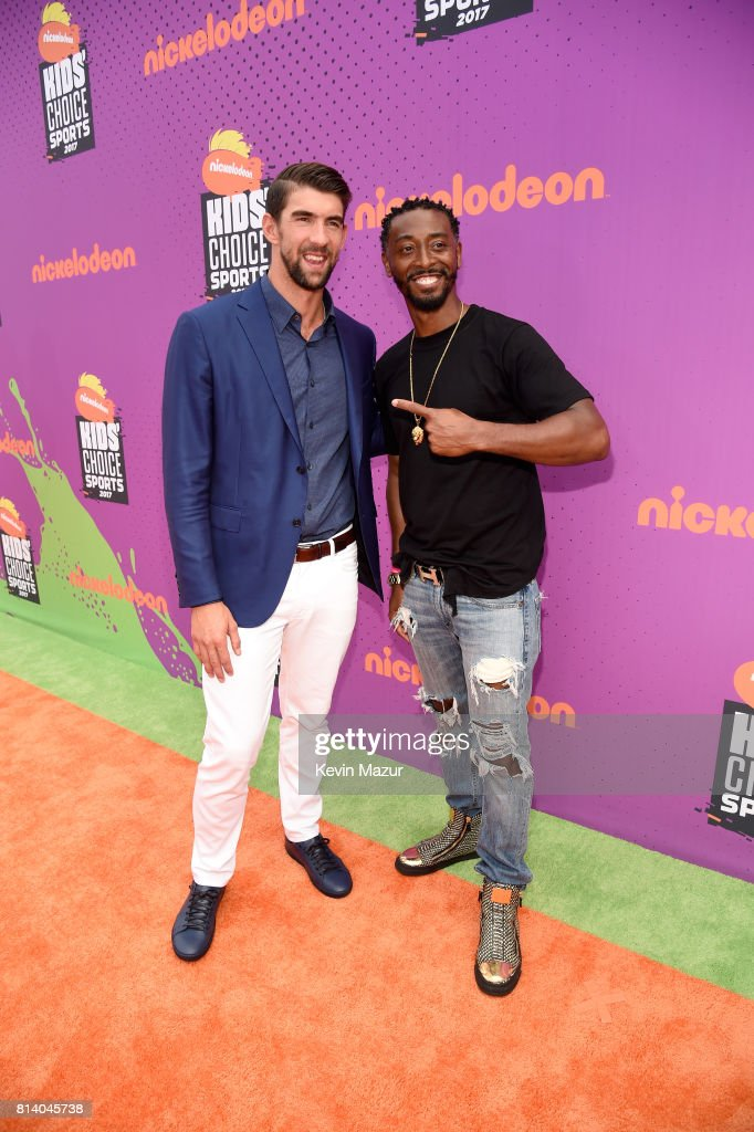 Honoree Michael Phelps (L) and actor Darris Love attend Nickelodeon Kids' Choice Sports Awards 2017 at Pauley Pavilion on July 13, 2017 in Los Angeles, California.