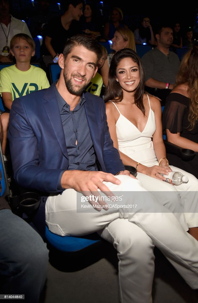 Honoree Michael Phelps (L) and model-Miss California USA 2010 Nicole Johnson attend Nickelodeon Kids' Choice Sports Awards 2017 at Pauley Pavilion on July 13, 2017 in Los Angeles, California.