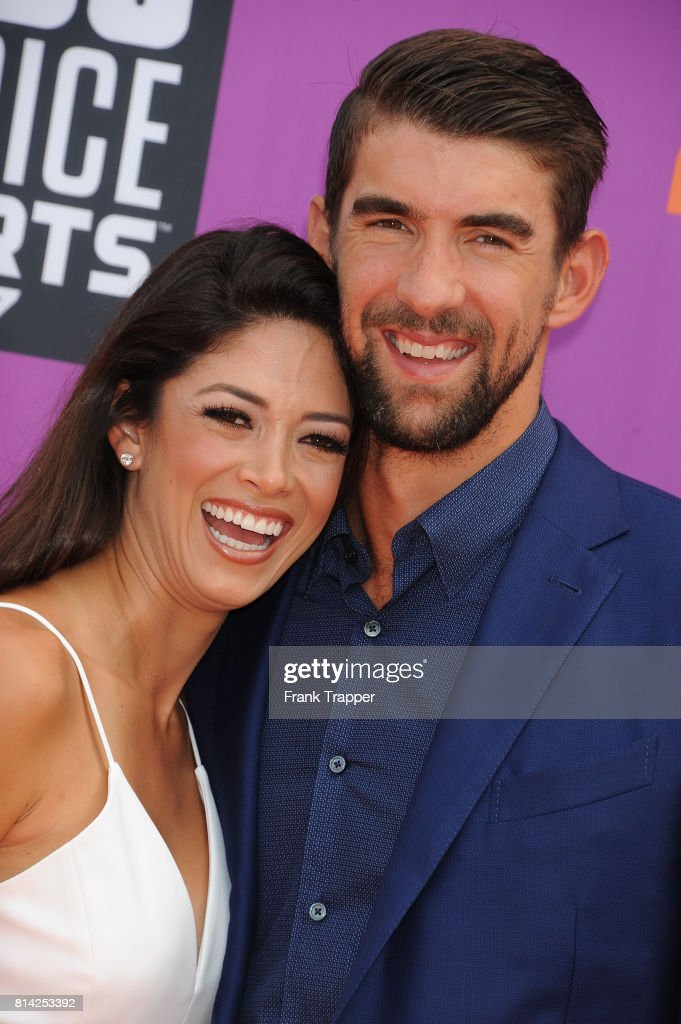 Honoree Michael Phelps and Nicole Johnson attend Nickelodeon Kids' Choice Sports Awards 2017 at Pauley Pavilion on July 13, 2017 in Los Angeles, California.
