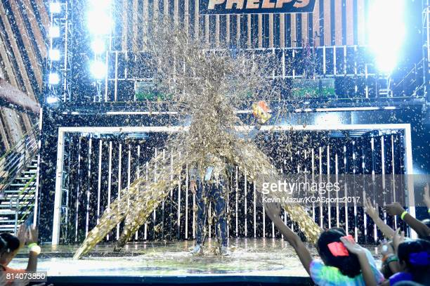 Honoree Michael Phelps gets slimed while accepting the Legend Award onstage during Nickelodeon Kids' Choice Sports Awards 2017 at Pauley Pavilion on...