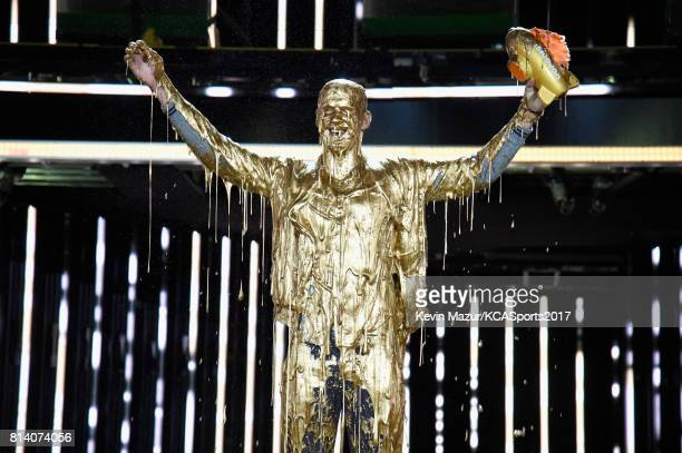 Honoree Michael Phelps reacts after getting slimed and accepting the Legend Award onstage during Nickelodeon Kids' Choice Sports Awards 2017 at...