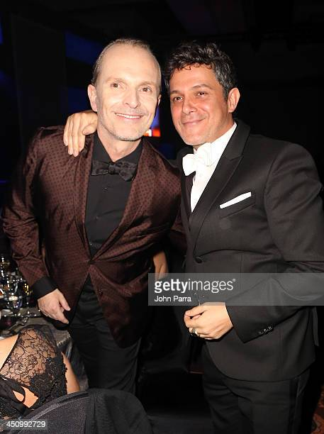 Honoree Miguel Bose and singer Alejandro Sanz pose in the audience during the 2013 Person of the Year honoring Miguel Bose at the Mandalay Bay...