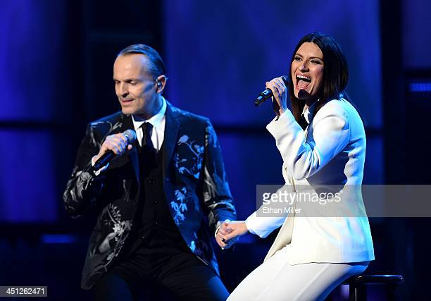 Honoree Miguel Bose and singer Laura Pausini perform onstage during the 14th Annual Latin GRAMMY Awards held at the Mandalay Bay Events Center on...