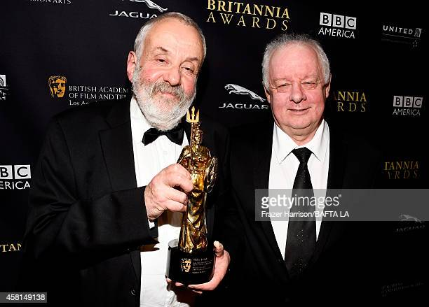 Honoree Mike Leigh OBE and director Jim Sheridan attend the BAFTA Los Angeles Jaguar Britannia Awards presented by BBC America and United Airlines at...