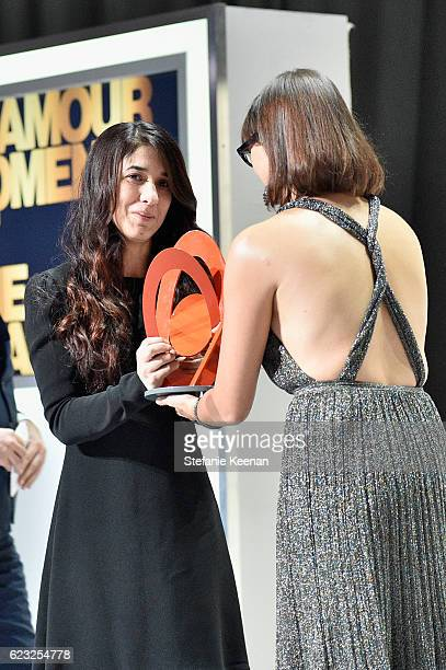 Honoree Nadia Murad accepts award from actress Rashida Jones onstage during Glamour Women Of The Year 2016 at NeueHouse Hollywood on November 14 2016...