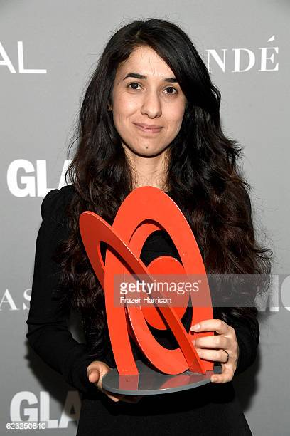 Honoree Nadia Murad poses with an award during Glamour Women Of The Year 2016 at NeueHouse Hollywood on November 14 2016 in Los Angeles California