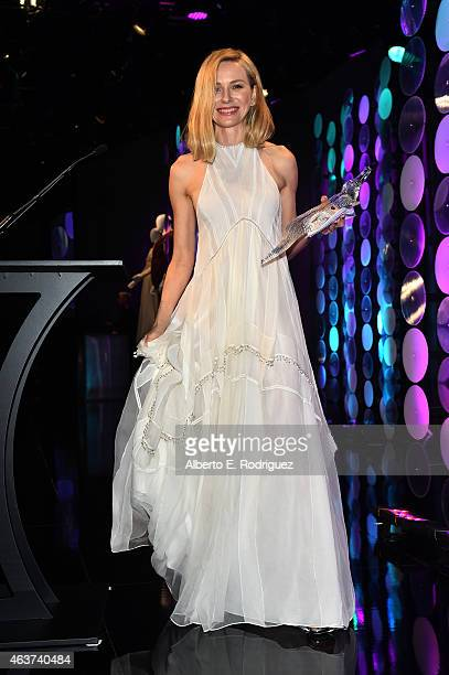 Honoree Naomi Watts recipient of the Lacoste Spotlight Award walks off stage during 17th Costume Designers Guild Awards with presenting sponsor...