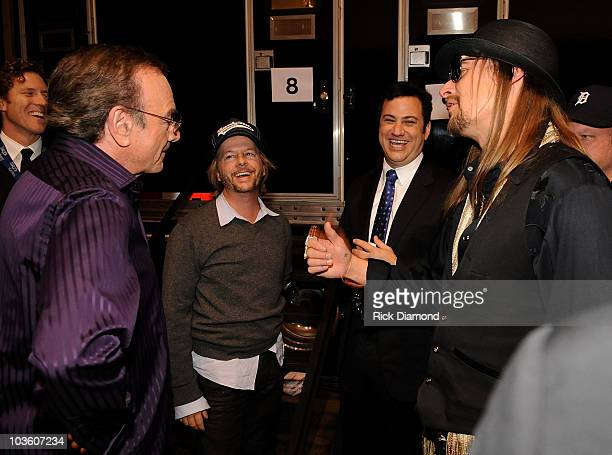 Honoree Neil Diamond, actor David Spade, comedian Jimmy Kimmel and musician Kid Rock backstage at the 2009 MusiCares Person of the Year Tribute to...