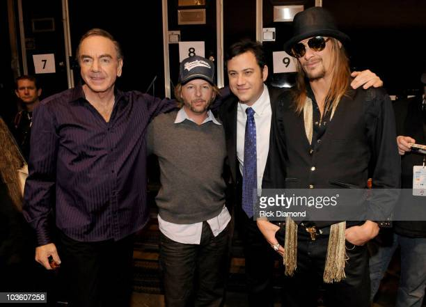 Honoree Neil Diamond, comedian David Spade, comedian Jimmy Kimmel and singer Kid Rock backstage at the 2009 MusiCares Person of the Year Tribute to...