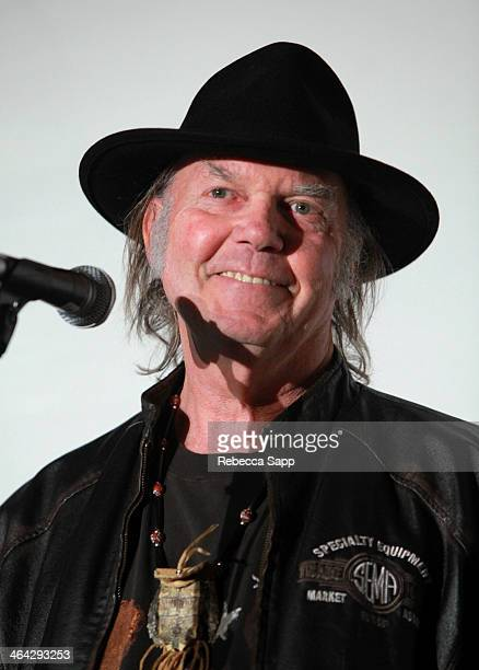 Honoree Neil Young accepts The Recording Academy President's Merit Award onstage during the 56th GRAMMY Awards PE Wing Event Honoring Neil Young at...