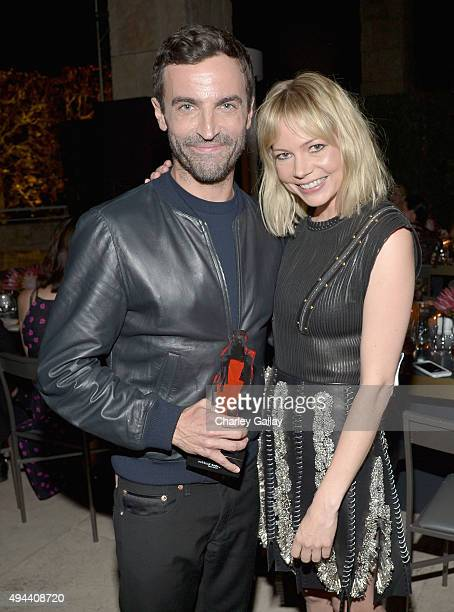 Honoree Nicolas Ghesquiere and actress Michelle Williams pose with an award during the InStyle Awards at Getty Center on October 26 2015 in Los...