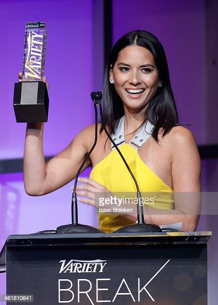 Honoree Olivia Munn accepts the Breakthrough Award for Actress onstage at the Variety Breakthrough of the Year Awards during the 2014 International...