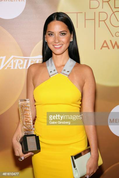 Honoree Olivia Munn poses with the Breakthrough Award for Actress backstage at the Variety Breakthrough of the Year Awards during the 2014...