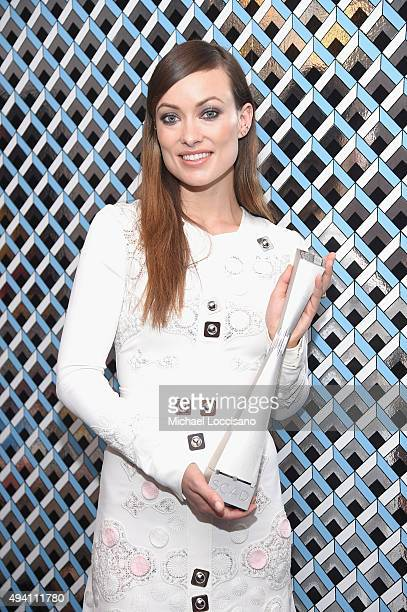 """Honoree Olivia Wilde poses with her Spotlight award as she attends the opening night screening of """"Suffragette"""" during 18th Annual Savannah Film..."""
