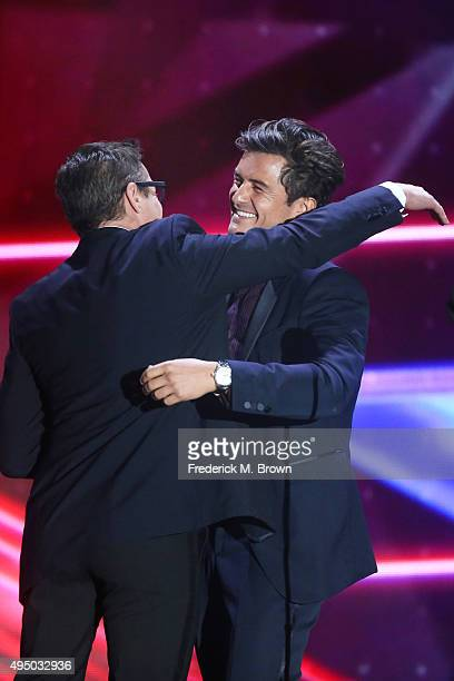 Honoree Orlando Bloom accepts the Britannia Humanitarian Award from actor Robert Downey Jr onstage during the 2015 Jaguar Land Rover British Academy...