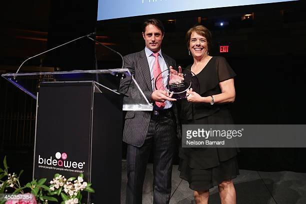 Honoree Prince Lorenzo Borghese and President and CEO of Bideawee Nancy Taylor speak onstage during the Bideawee Masquerade Ball at Gotham Hall on...