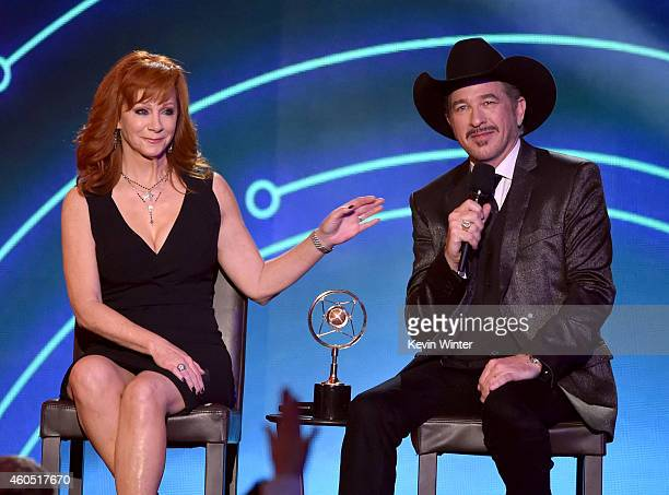 Honoree Reba McEntire accepts the NASH Icon Award from recording artist Kix Brooks onstage during the 2014 American Country Countdown Awards at Music...
